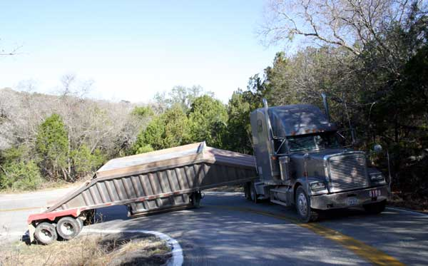 Jackknifed truck east of the Pedernales River on Hamilton Pool Road